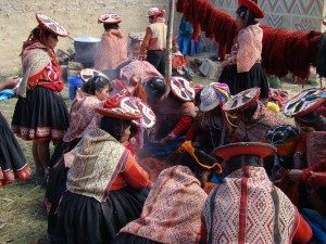 Photo from a group dye day in Accha Alta, in which the weavers are rinsing out a batch of freshly dyed yarn. During one of these events, the CTTC goes to the community with all the materials needed for dyeing and the weavers bring all the yarn they have prepared, to be sorted and dyed depending on the colors they want to weave with.