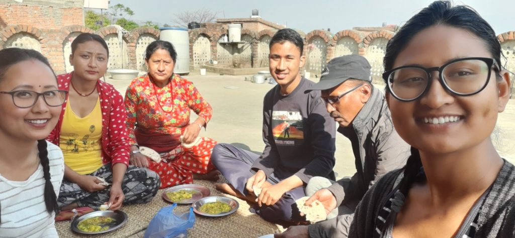 Nepali family eating lunch