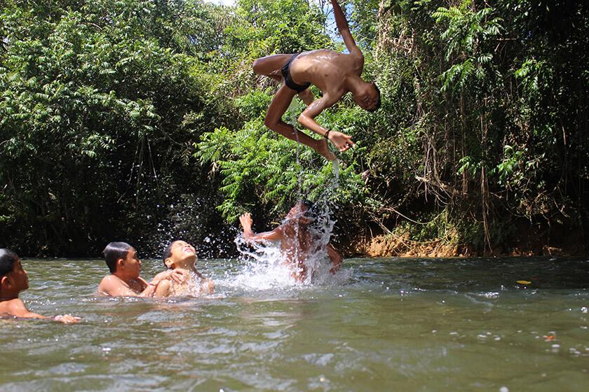 village kids swim and play