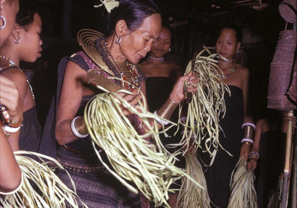 A Rungus bobolizan (priestess/spirit medium) in a trance dance during a moginum, a renewal ceremony for the domestic family unit in the longhouse in Sabah, Borneo. Photo: George N. Appell, from fieldwork in 1959-1963