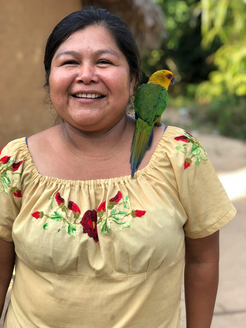 pet parakeet on shoulder