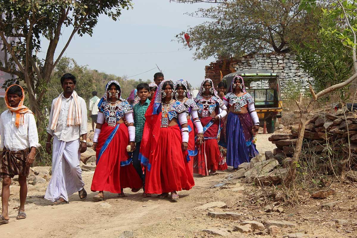 community in bright attire.